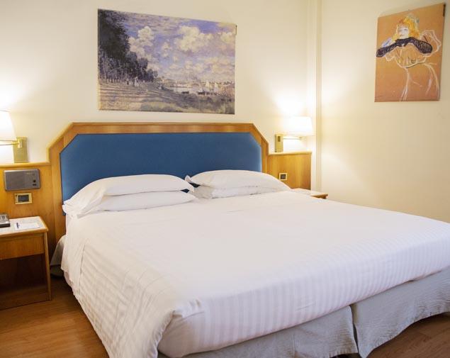 ih-hotels-milano-eur-trezzano-camera-deluxe-matrimoniale